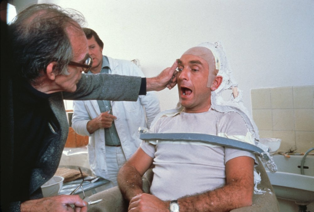 Actor Paul Freeman sits in the makeup chair, ready to have his face transformed for a heated moment as the villainous French archaeologist Belloq