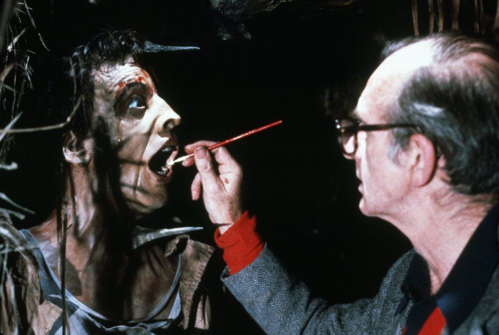 Adding the finishing touches to the special makeup effects for the opening scene in which one of Belloq's greedy stooges gets his comeuppance