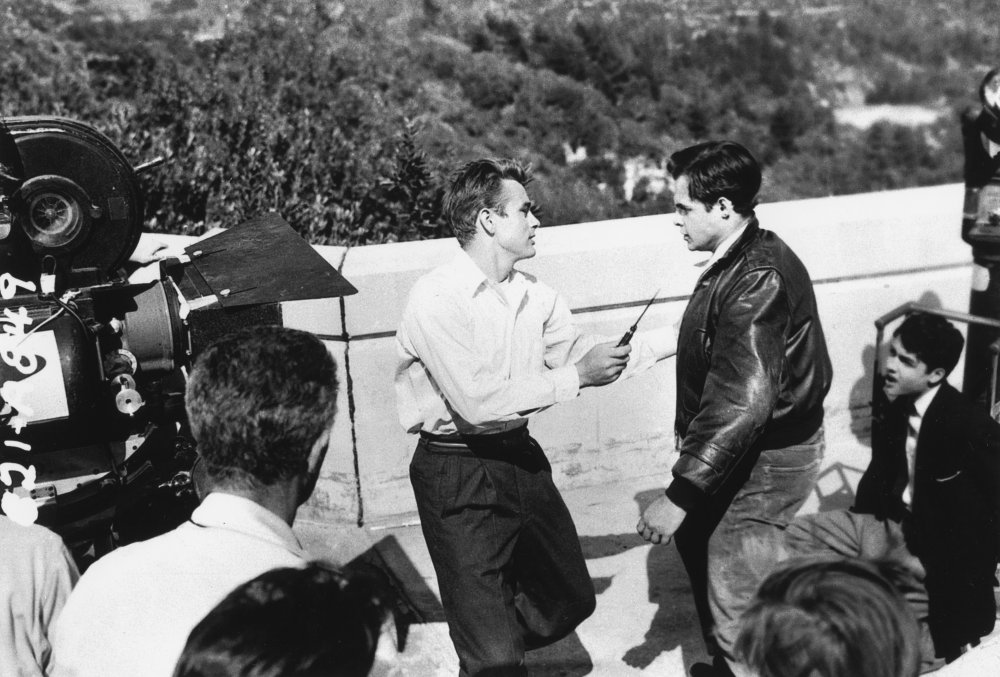 James Dean and Corey Allen (as troublemaker Buzz Gunderson) film the thrilling knife-fight scene on the terrace of the Griffith Observatory in Los Angeles