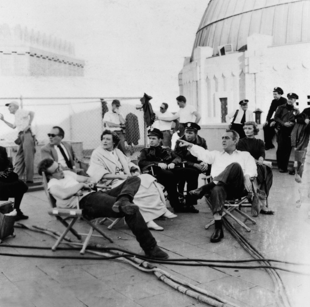 Between takes, Dean slouches in his chair with his on-screen parents Jim Backus and Ann Doran (who play Mr and Mrs Stark) and a cast of cops at Griffith Observatory