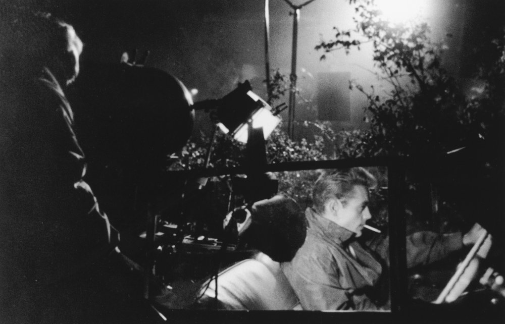 Lights, camera and action on a night-time shoot for Rebel without a Cause (1955), with James Dean taking his place behind the wheel as outsider teen Jim Stark