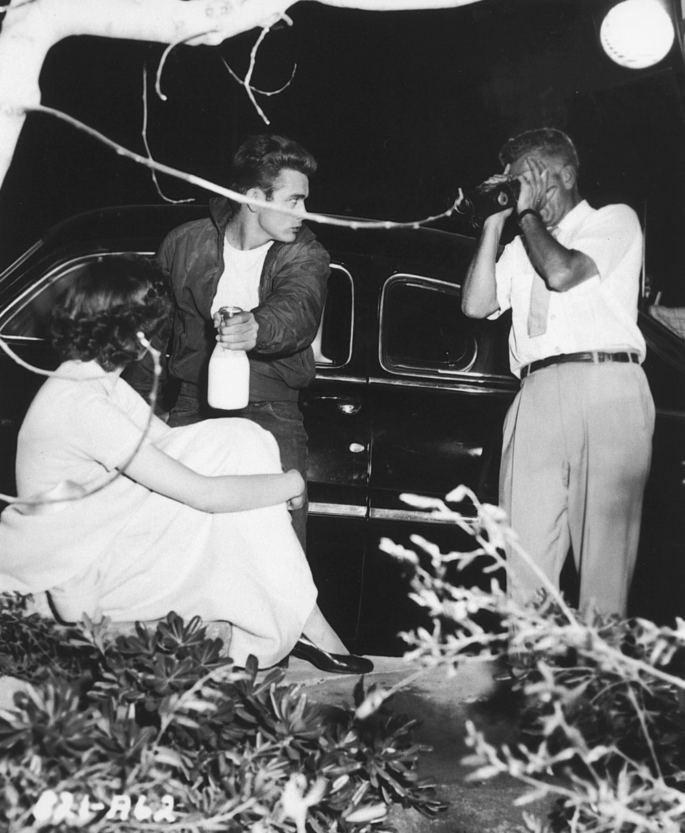 Milking the moment: director Nicholas Ray checks his viewfinder before filming a turbulent moment between James Dean and Natalie Wood