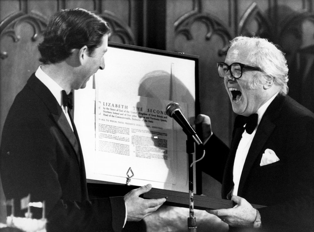 The Prince of Wales, patron of the British Film Institute, and Sir Richard Attenborough, its chairman, find lots to amuse them as the Prince hands over a Royal Charter during the BFI's 50th anniversary celebratory banquet at Guildhall in London