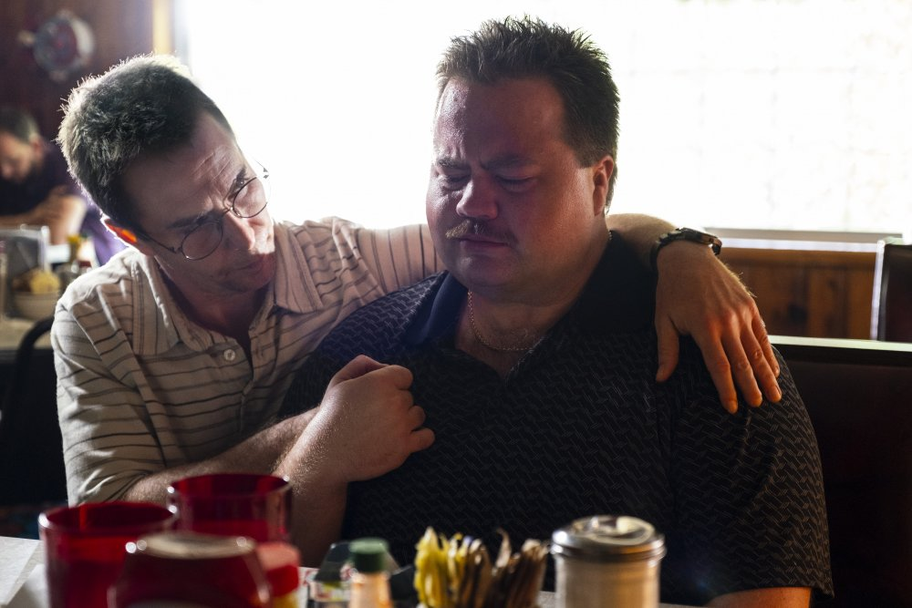 Sam Rockwell as Watson Bryant and Paul Walter Hauser as the titular Richard Jewell