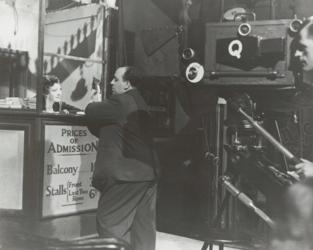 Sylvia Sidney talking to Alfred Hitchcock on the set of Sabotage