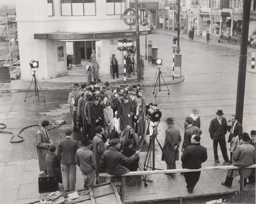 Hitchcock (on railing) watching a scene from Sabotage