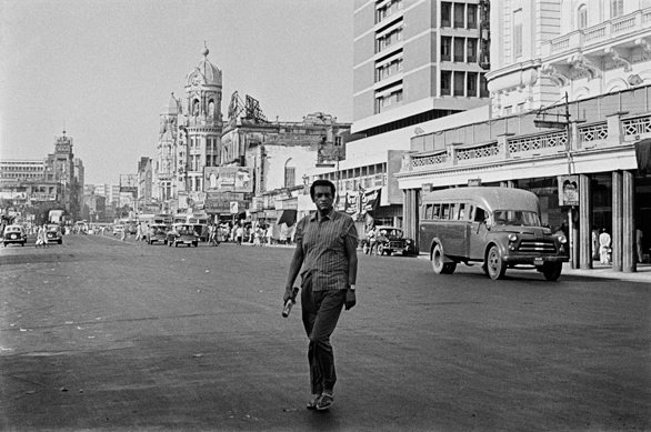 Satyajit Ray in front of the Grand Hotel in Calcutta's Chowringhee, scouting for locations for Company Limited (1971)