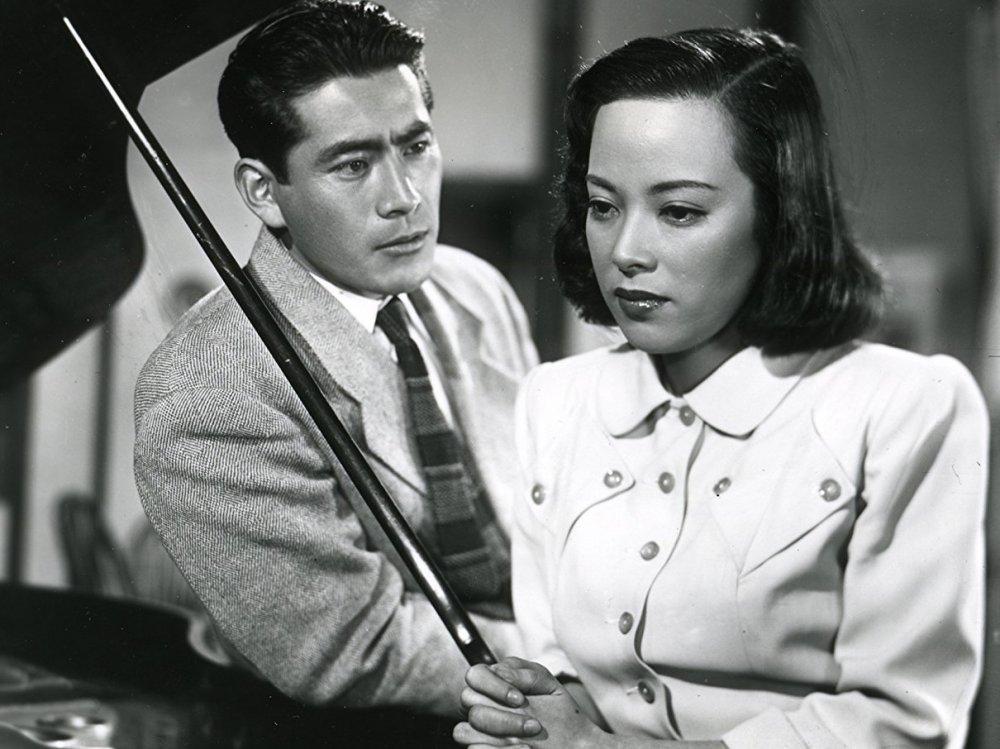 Yamaguchi Yoshiko with Toshiro Mifune in Akira Kurosawa's Scandal (1950)