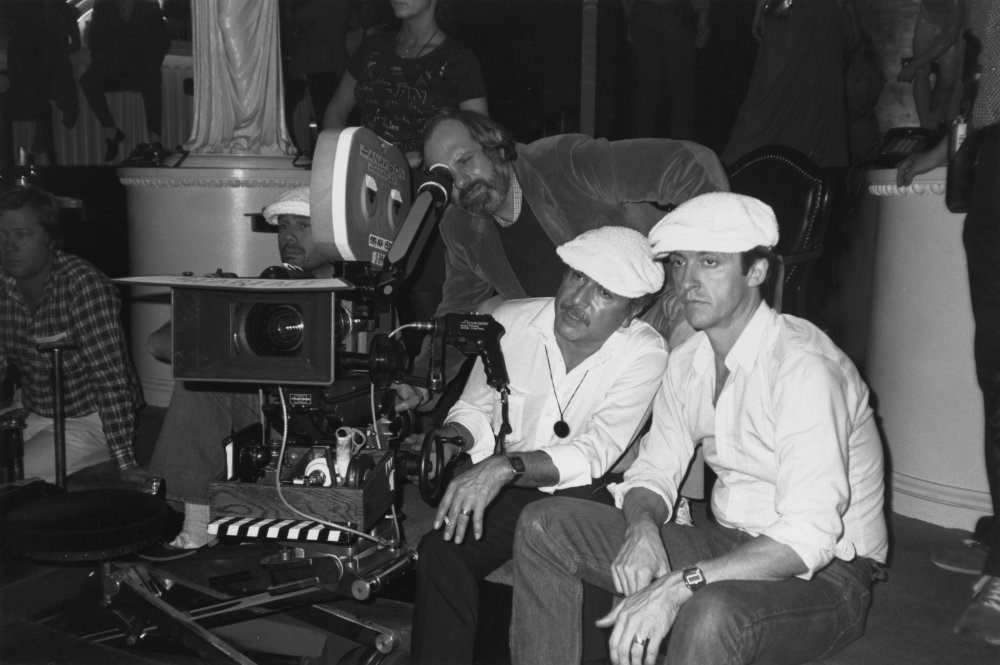 De Palma checks out a shot, with cinematographer John A. Alonzo and Al Pacino standing by