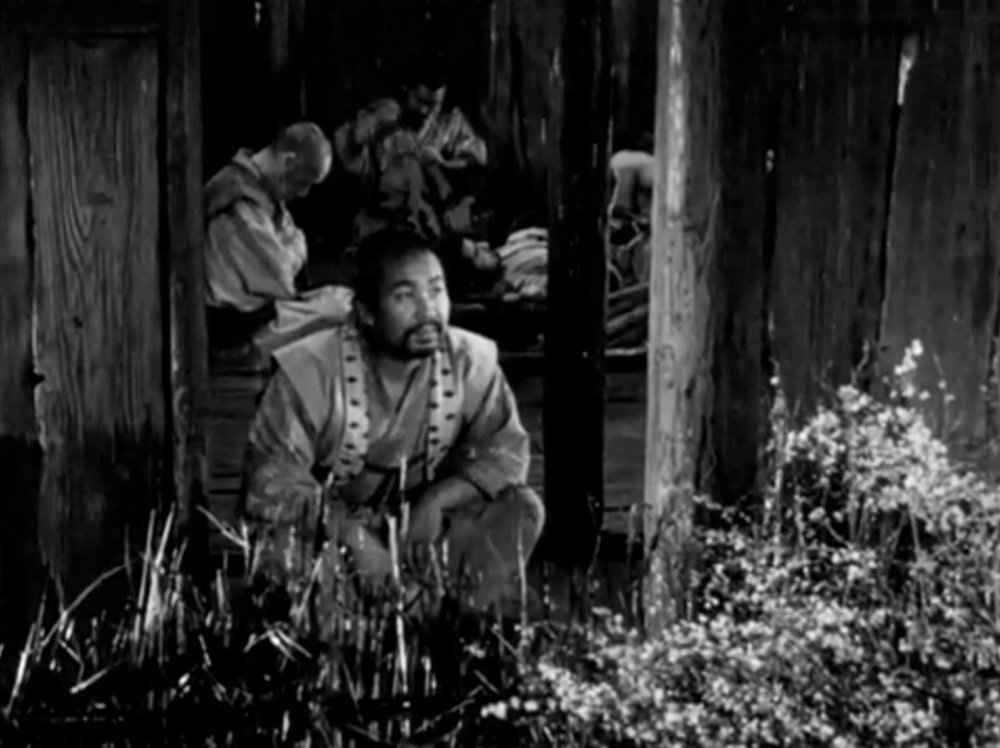 In this scene with the samurai sheltering in their hut in the village, the rain emphasises the sense of disquieting stillness in the run up to the inevitable raid