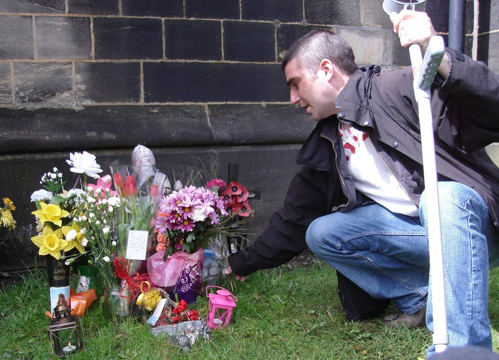 Silly at Nicola's grave in Jez Lewis's Shed Your Tears and Walk Away