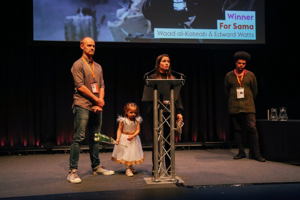 Edward Watts, Sama and Waad al-Kateab accepting Grand Jury's Special Mention for For Sama at Sheffield Doc/Fest 2019