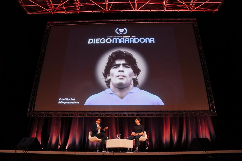 Diego Maradona director Asif Kapadia and Sheffield Doc/Fest head programmer Luke Moody on stage at the festival's 2019 opening night