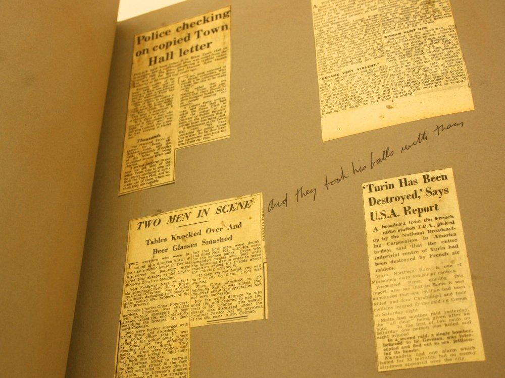 """Newspaper cuttings in the scrapbook, with the handwritten note """"and"""