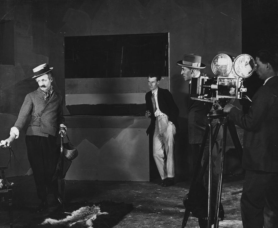 Director Asquith on the set of Shooting Stars with A.V. Bramble, supervising director and probably photographer Stanley Rodwell behind his Bell & Howell 2709