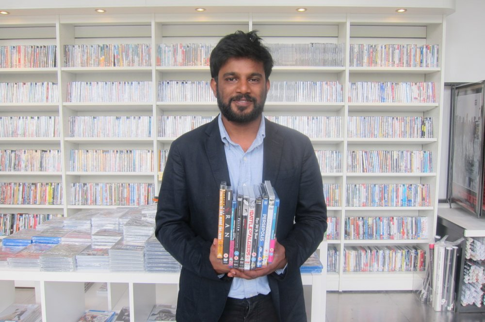 Shubhashish Bhutiani holding DVDs of some of his favourite films in the BFI Shop