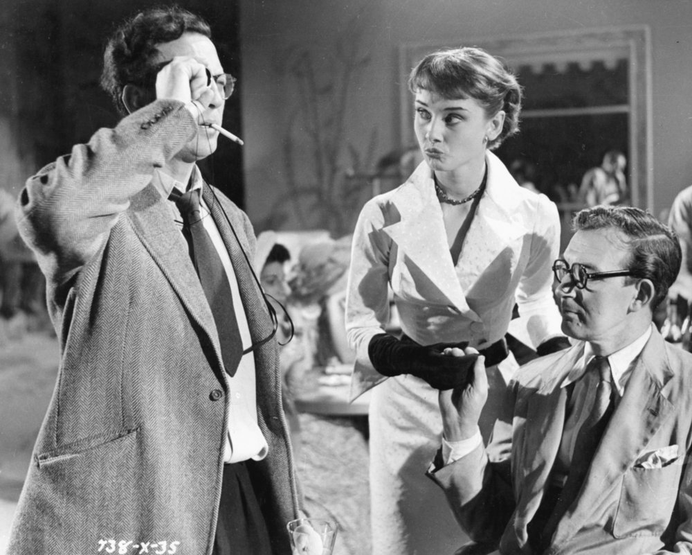 Left to right: Slocombe, Audrey Hepburn and director Charles Crichton on the set of The Lavender Hill Mob (1951)