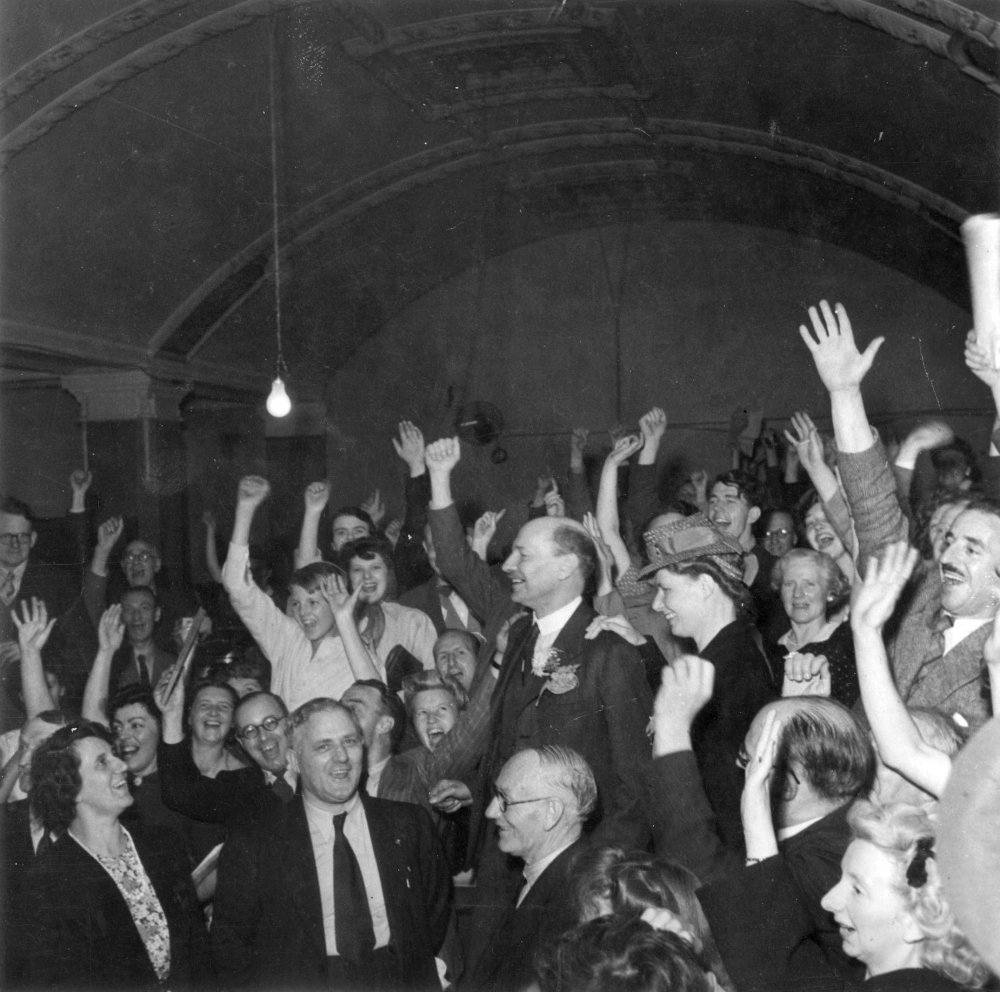 Partying politics: Clement Attlee and supporters celebrate Labour's triumph in the 1945 general election