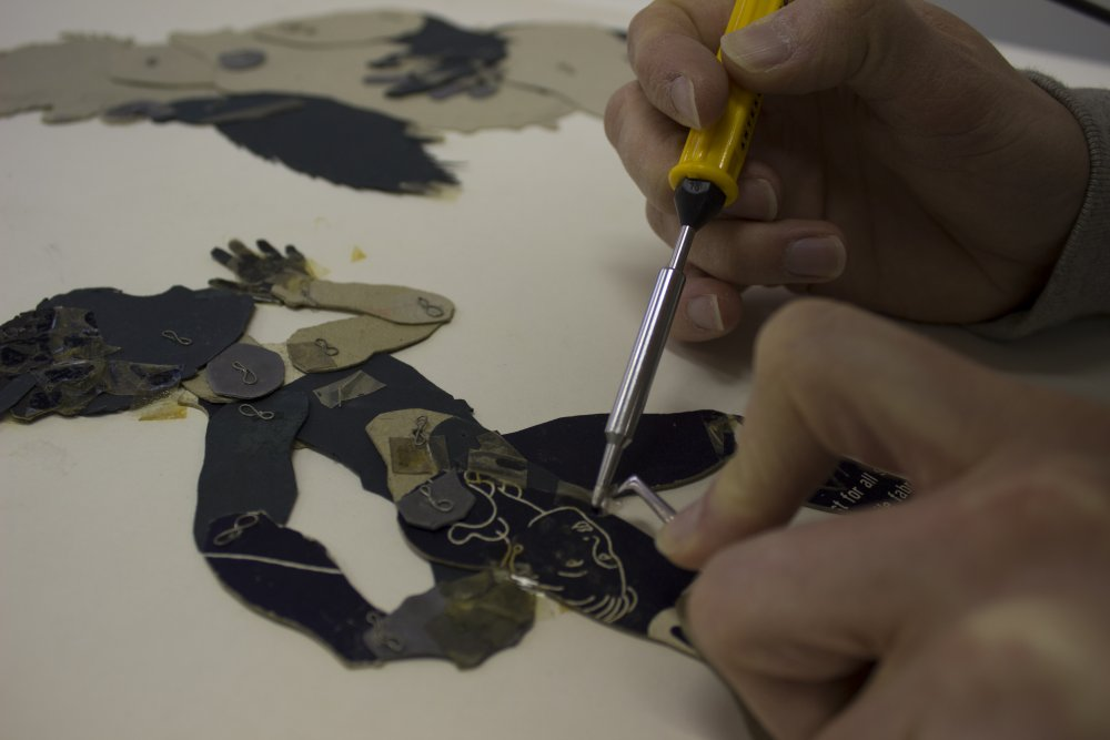 Using a heat pen to restore one of Reiniger's silhouette figures