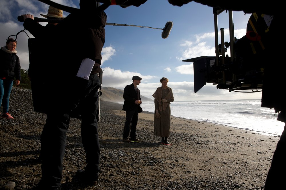 Filming a scene with Agyness Deyn on the beach