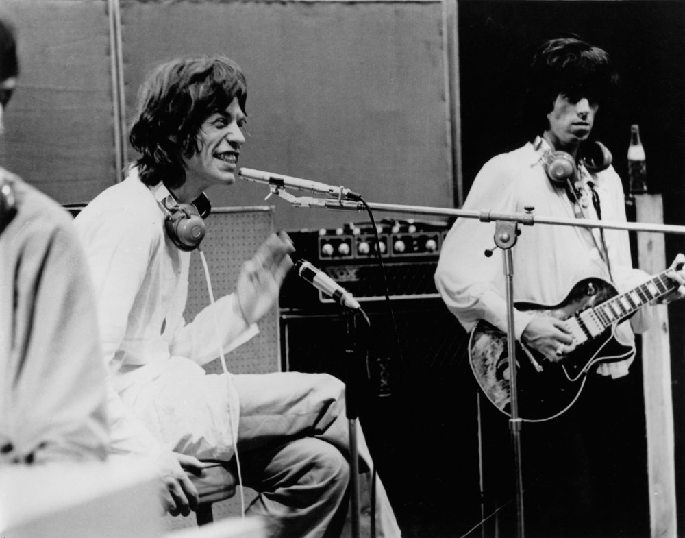 Mick Jagger during the studio sessions. These Barnes studios were once a theatre, then a cinema, then a TV studio, before Olympic Studios moved into the building in 1964. During filming, a fire started caused by a bulb exploding near some of the sound diffusion paper put up by the director. A recording session had to be conducted the following day with a hole in the building caused by the subsequent fire