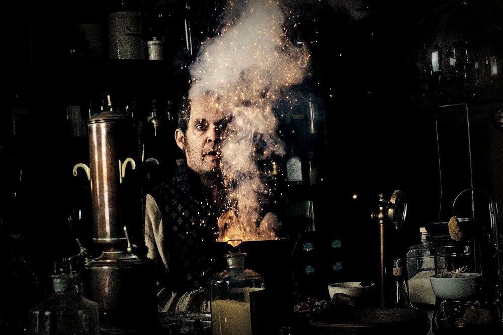 Tom Hollander as gunpowder chemist Dr. George Cholmondeley