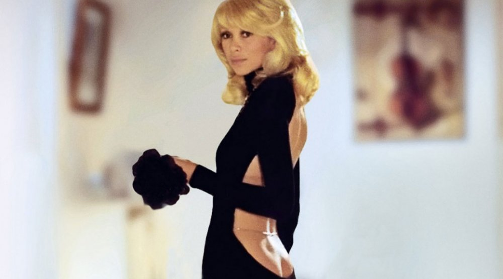 Mireille Darc wears her famous dress in The Tall Blond Man with One Black Shoe (1972)