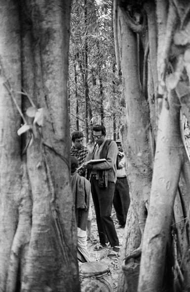 Nemai Ghosh's first portrait of Ray: Ghosh took this photograph of Ray rehearsing with actors Tapen Chatterjee and Robi Ghosh (back to the camera) on location of The Adventures of Goopy and Bagha (1968)