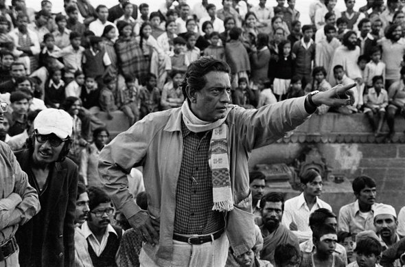 Ray managing crowds on location at Chausath Ghat in Benares for The Elephant God (1978)
