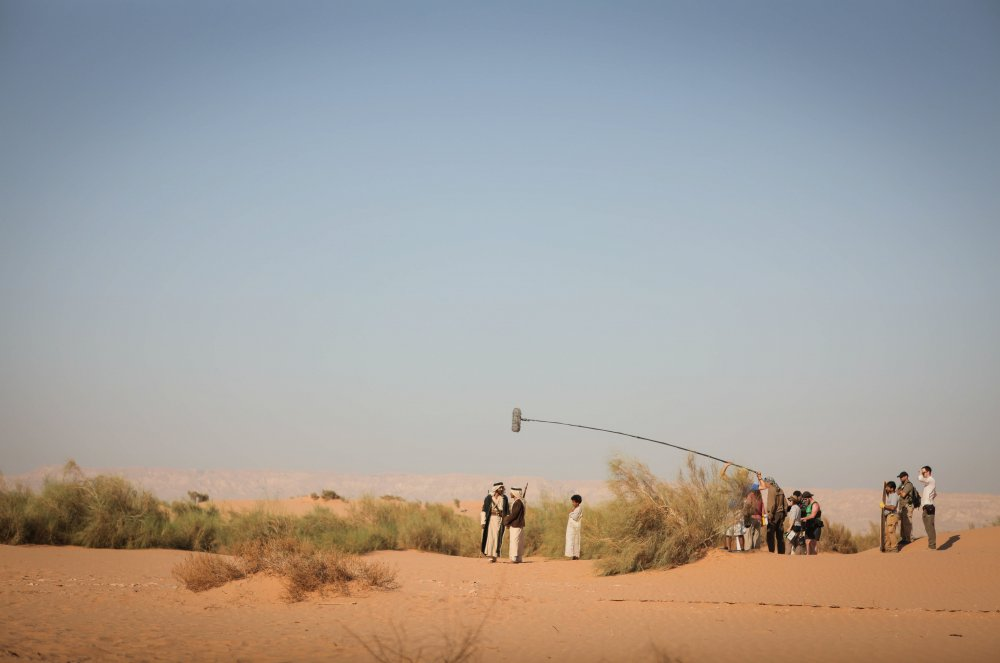 The cast perform a scene in the military zone in Wadi Arabah, which lies on the border with Israel, seen in the distance. The production had to obtain special permission to shoot here and had to be accompanied by the army at all times