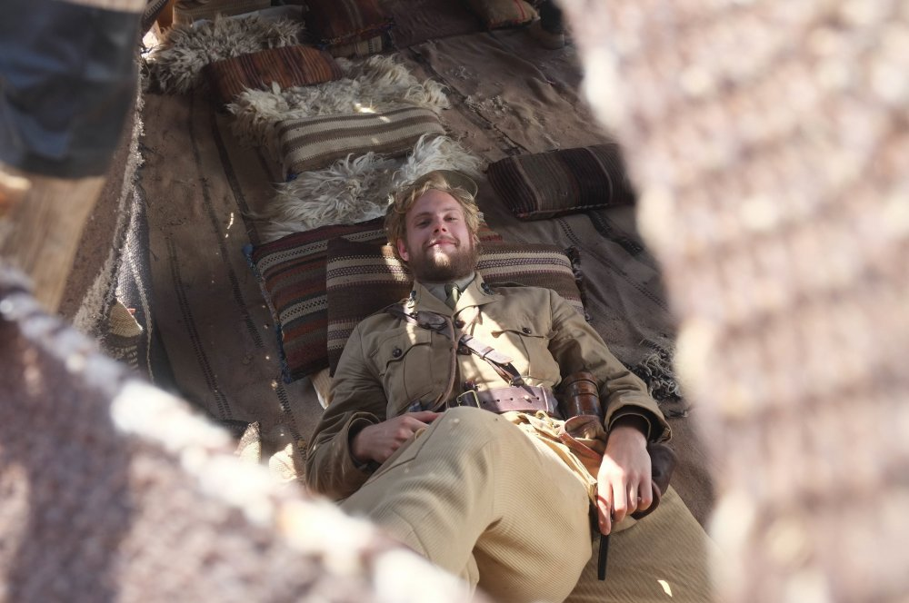 Jack Fox shelters from the sun in a traditional Bedouin tent between scenes. Temperatures were regularly above 40C (104F)
