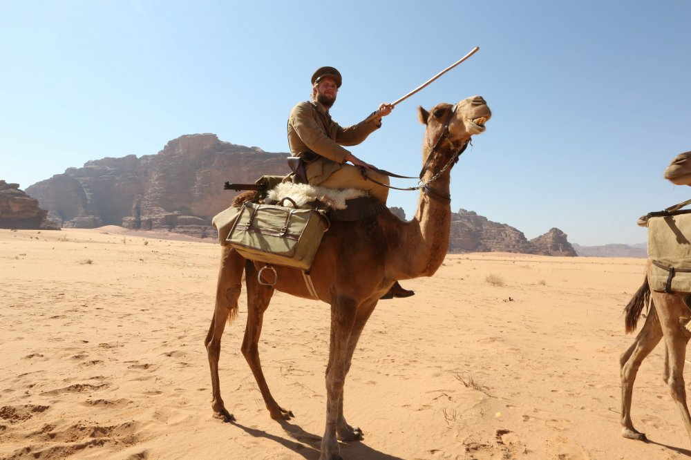 Jack Fox with his rather badly behaved camel