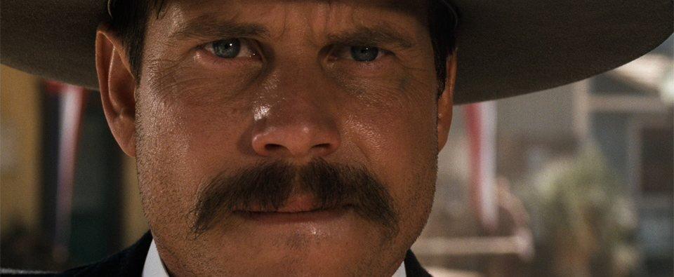 As sibling Morgan Earp in George Pan Cosmatos's Tombstone (1993)
