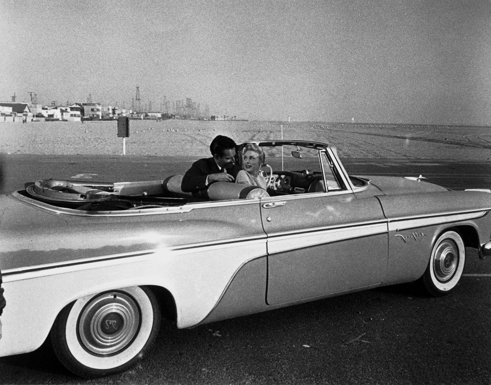 Charlton Heston and Janet Leigh between takes in a gleaming 1956 De Soto Fireflite convertible