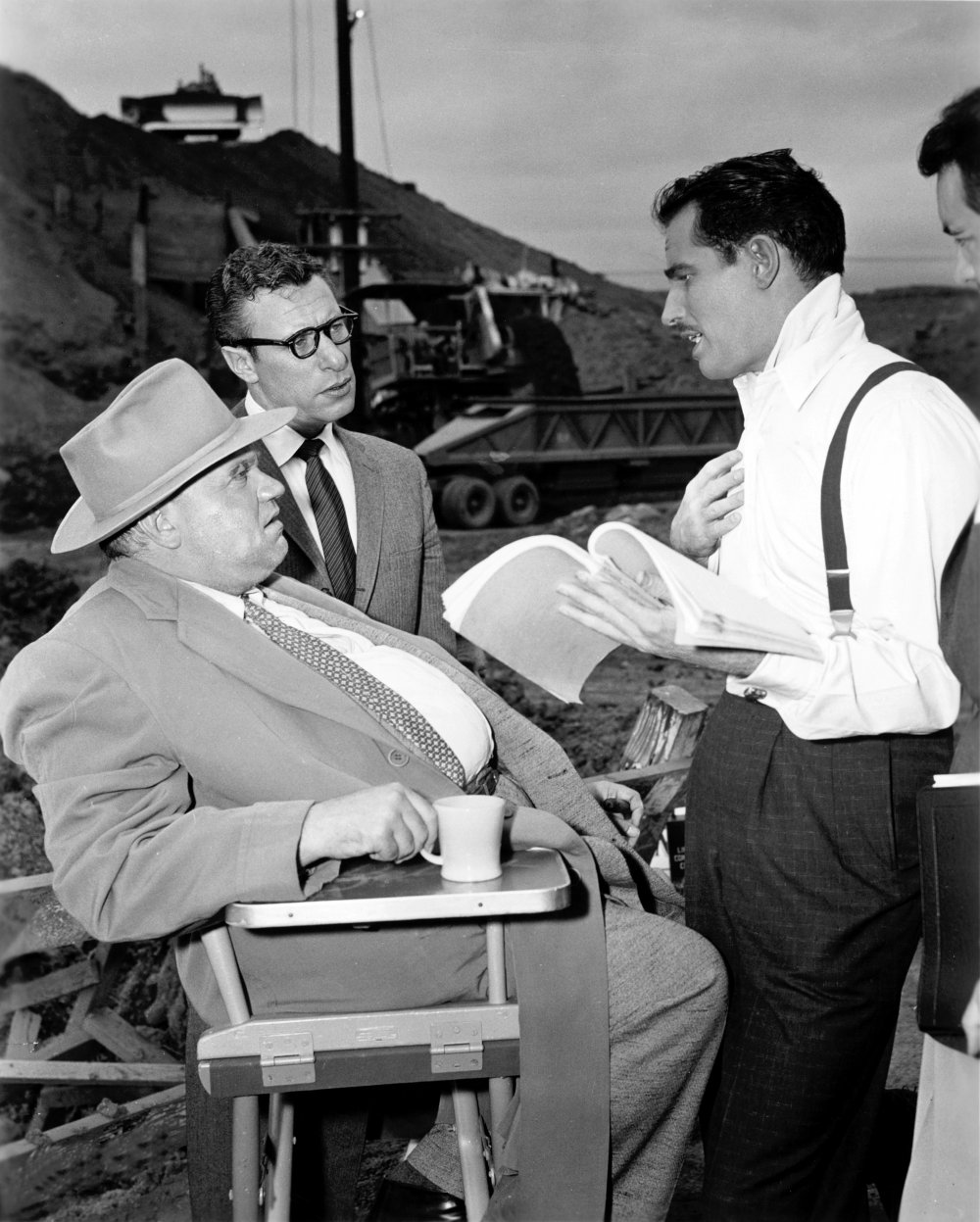 Orson Welles with actors Mort Mills and Charlton Heston during filming of Touch of Evil (1958)