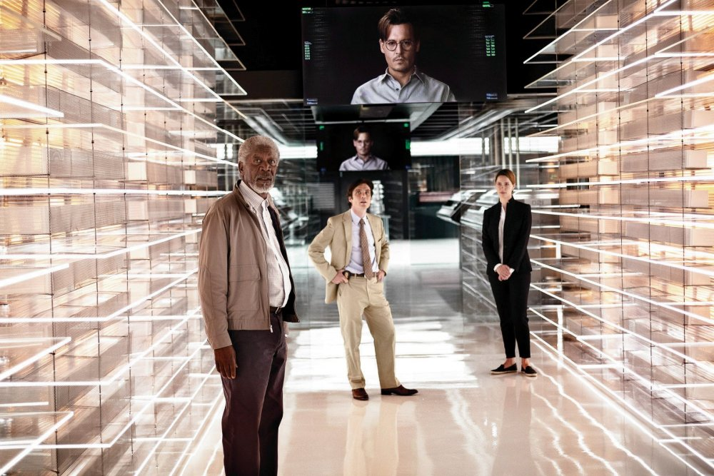 Get with the program: Johnny Depp floats over his co-stars as artificial intelligence expert Will Caster, who has his mind uploaded to a computer