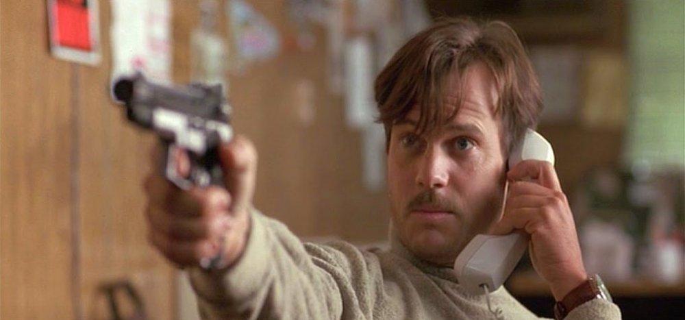 As Arnold Schwarzenegger's wing man Simon in Cameron's True Lies (1994)