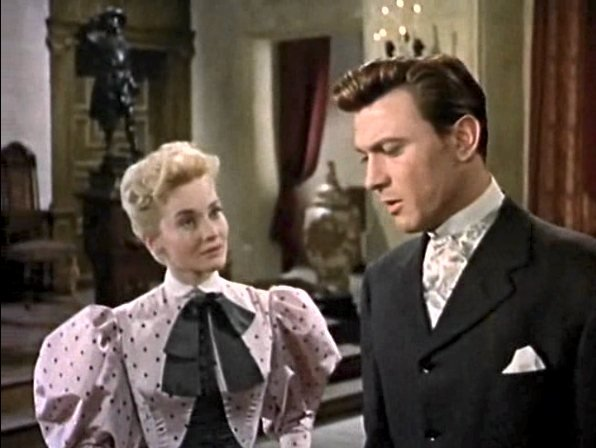 Eva Gabor and Laurence Harvey in The Truth about Women (1957)