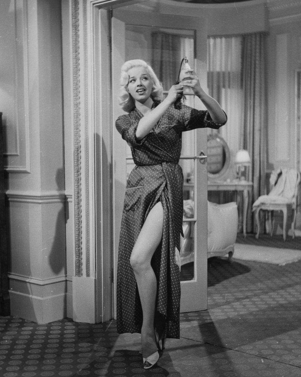 In Value for Money (1955), nightclub singer Diana Dors meets a newly-rich young man from Yorkshire and decides to have some fun with his money