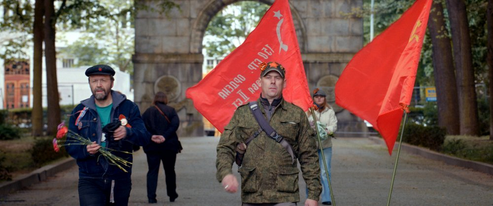 Commemorative marchers at Berlin's Soviet War Memorial in Victory Day