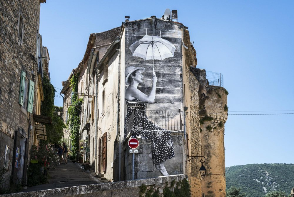 A mural by artist J.R. as featured in his and Agnès Varda's documentary Visages Villages, which premiered out of competition at Cannes