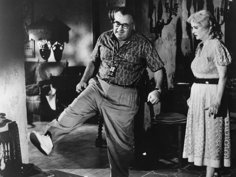 """Director Robert Aldrich and star Bette Davis during the production of """"What Ever Happened to Baby Jane?"""" (1962)"""