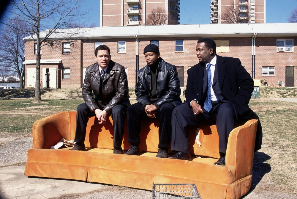 Detectives McNulty (Dominic West, left) and Bunk (Wendell Pierce, right) with dealer D'Angelo Barksdale (Larry Gilliard Jr.) in season one