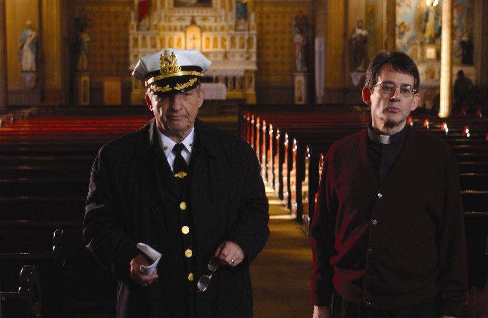 Major Stanislaus Valchek (Al Brown) and a priest