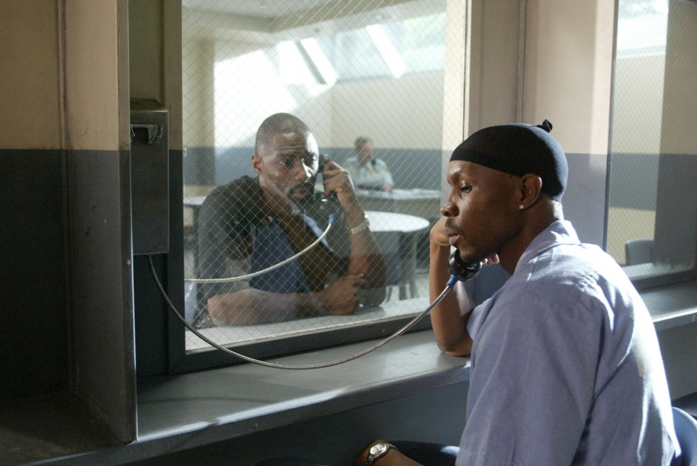 Avon Barksdale (Wood Harris, right) is visited in jail by his second-in-command Stringer Bell (Idris Elba)