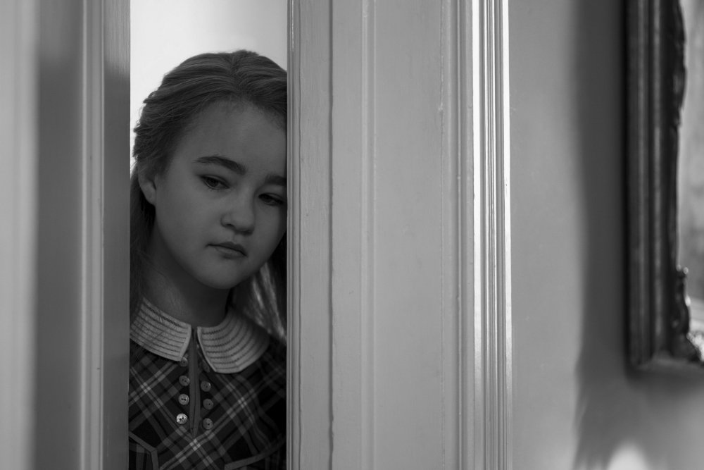 Millicent Simmonds as the young Rose