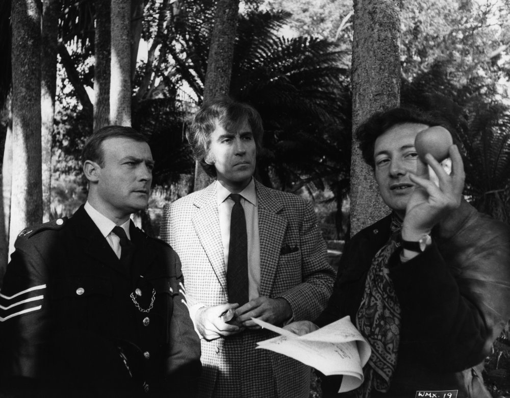 Actors Edward Woodward and Christopher Lee and director Robin Hardy filming The Wicker Man (1973)