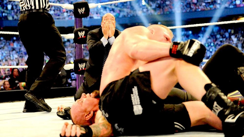 Brock Lesnar (above) trumps The Undertaker