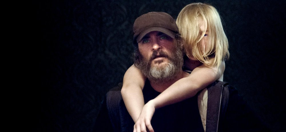 Joaquin Phoenix as 'enforcer' Joe and Ekaterina Samsonov as Nina in You Were Never Really Here (2017)
