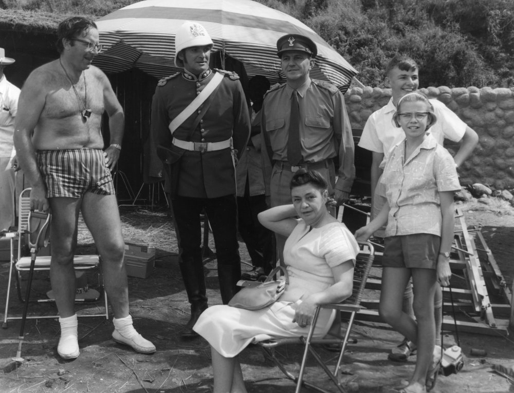 Director Cy Endfield dressed for the South African heat in short shorts. Endfield had previously directed Stanley Baker (second left) in the cult truck-driving thriller Hell Drivers (1957).